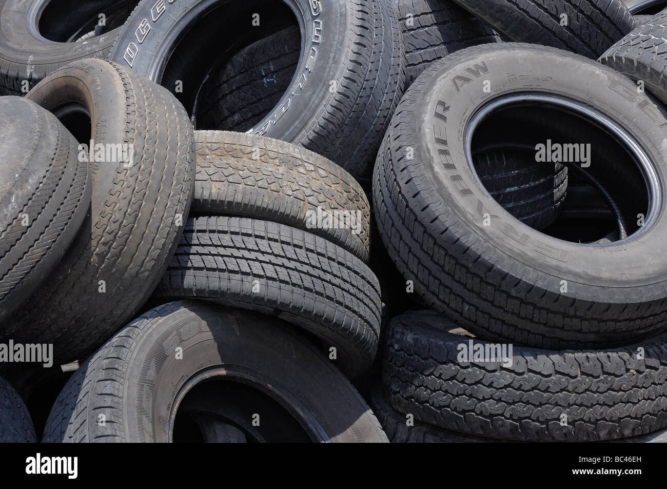 A pile of worn used tires sits in back of  an auto repair shop, Florida. - Stock Image