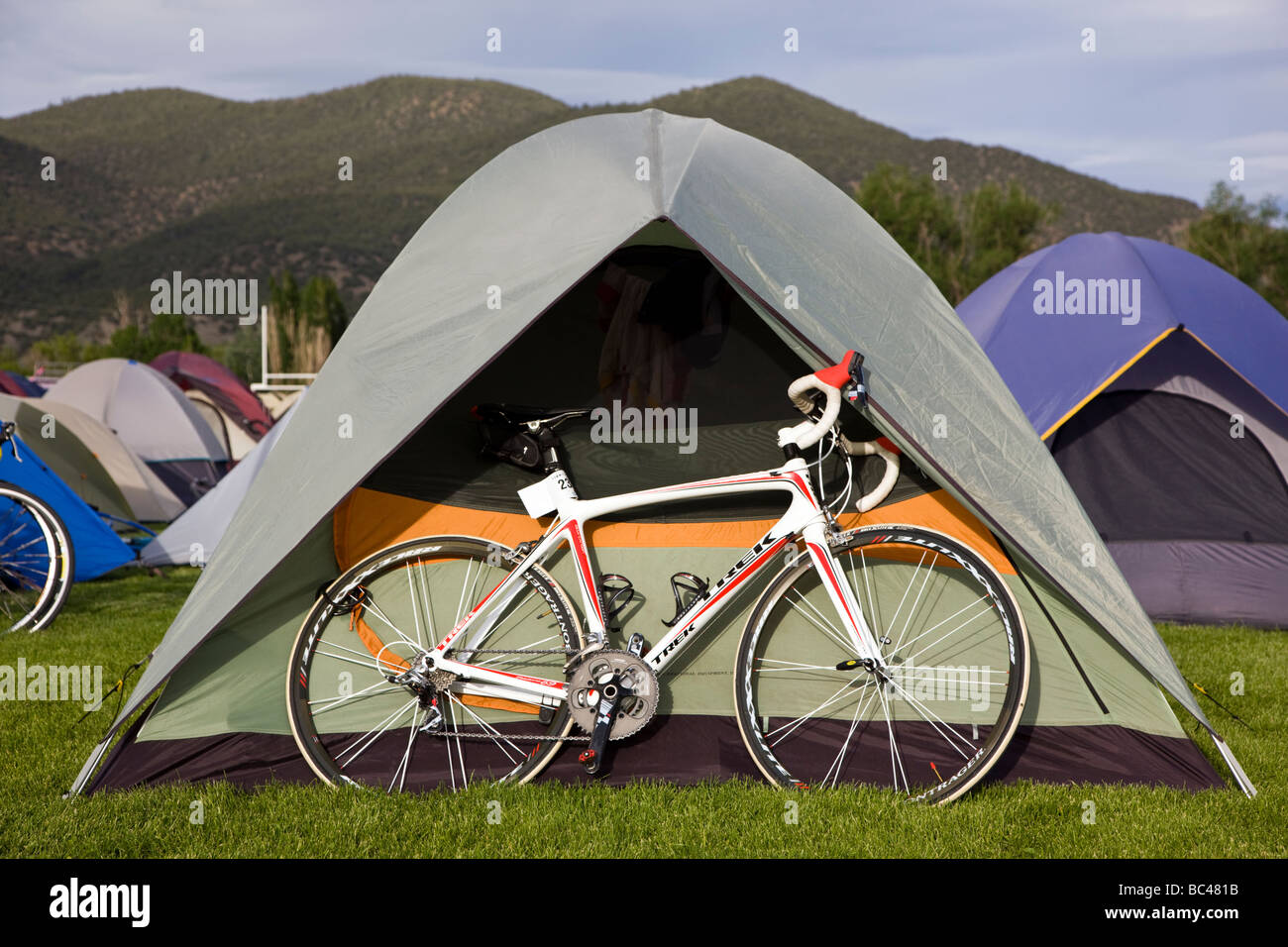 Cyclists camping at the Salida High School in Colorado during the annual Ride The Rockies bicycle tour - Stock Image