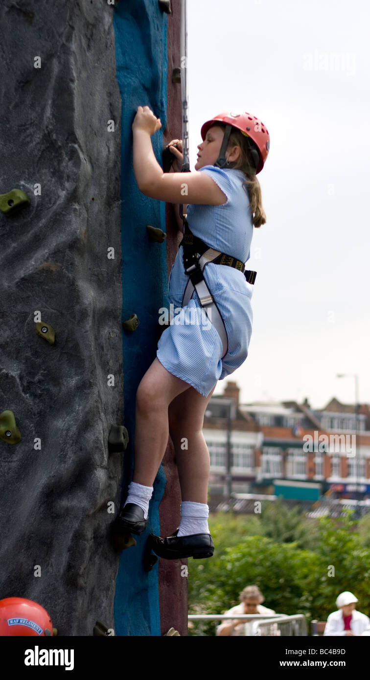 A schoolchild tries some climbing on an army training course. Stock Photo