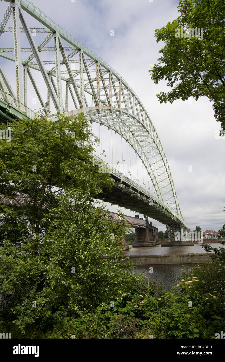 Silver Jubilee Bridge crosses the River Mersey and the Manchester Ship Canal at Runcorn Gap between Runcorn and - Stock Image