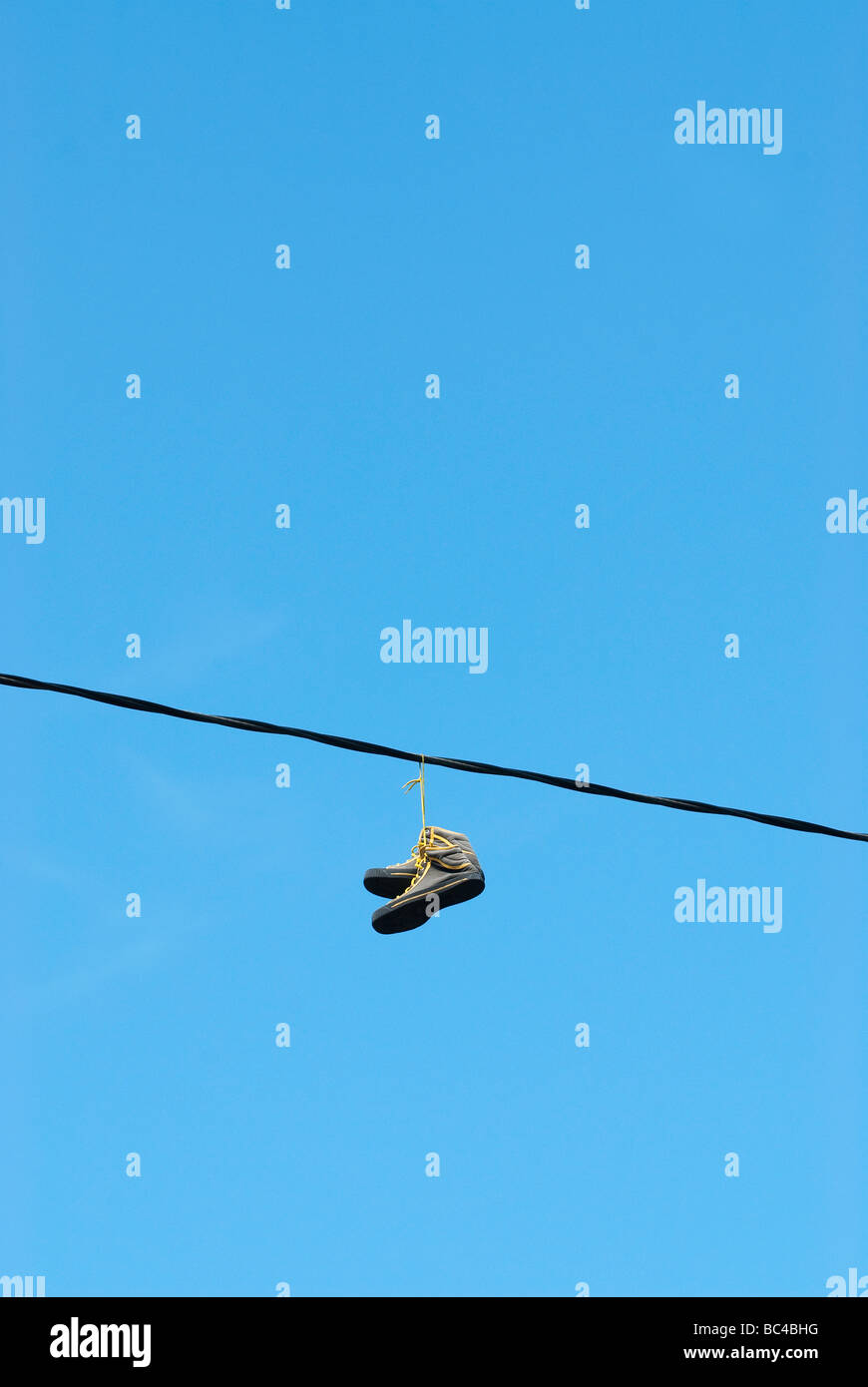 Shoes Hanging Laces On Wire Stock Photos & Shoes Hanging Laces On ...