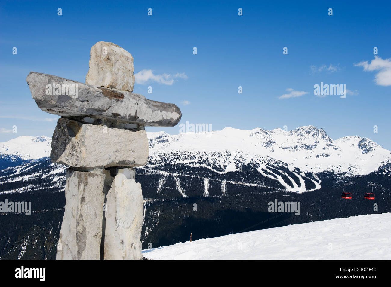 an Inuit Inukshuk stone statue Whistler mountain resort venue of the 2010 Winter Olympic Games - Stock Image