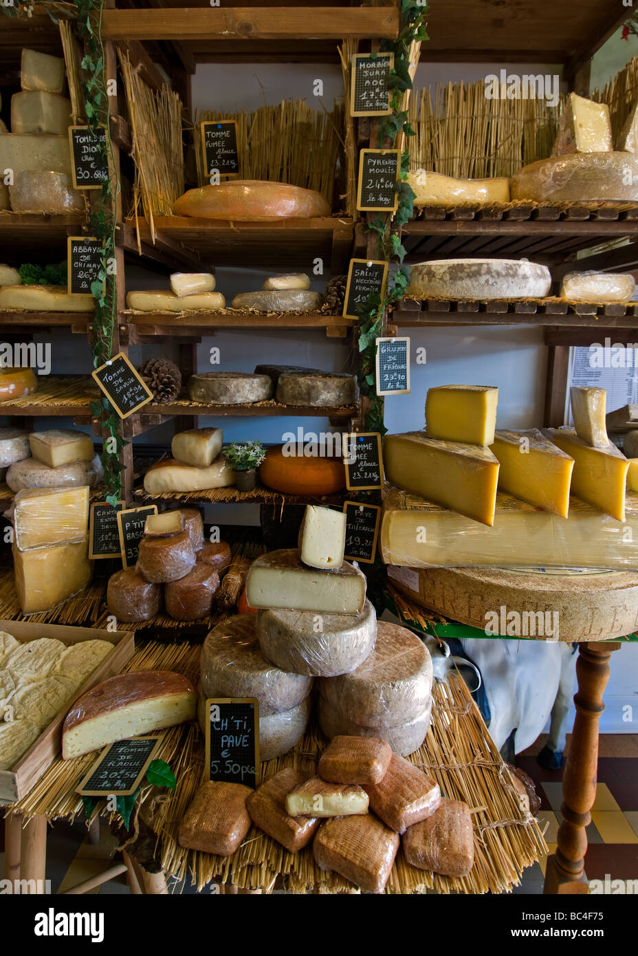 Selection of handmade cheeses on display in the charming artisan fromagerie cheese shop 'Caseus' Montreuil - Stock Image
