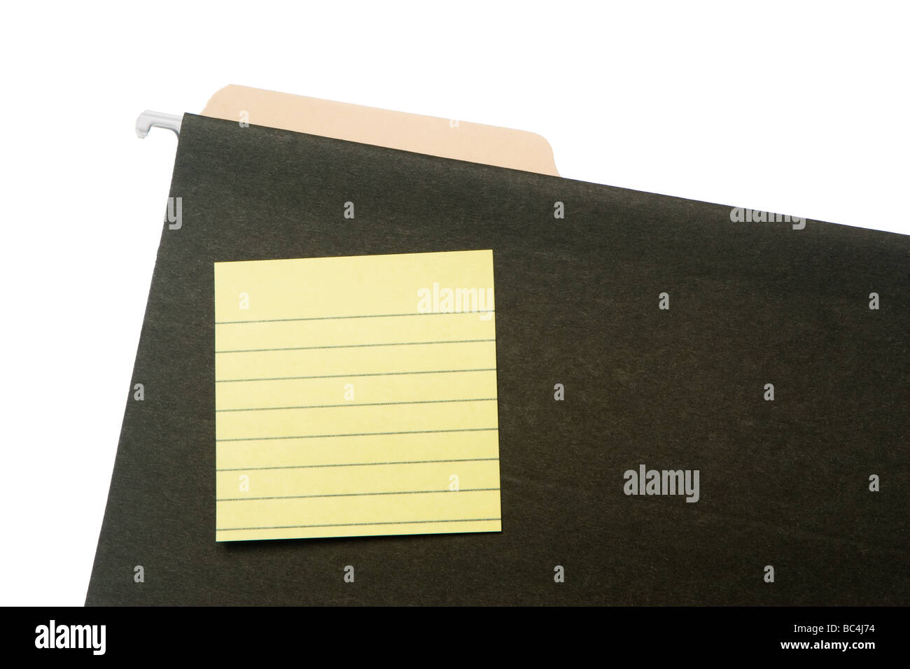 Blank lined post it note on green hanging file folder. Tab of manila folder inside hanging folder. Isolated on white. - Stock Image