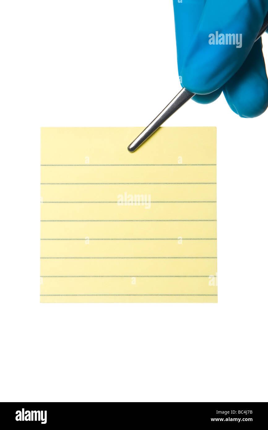 Post it note held by silver tweezer that s held by fingers in blue surgical glove. Isolated on white. - Stock Image
