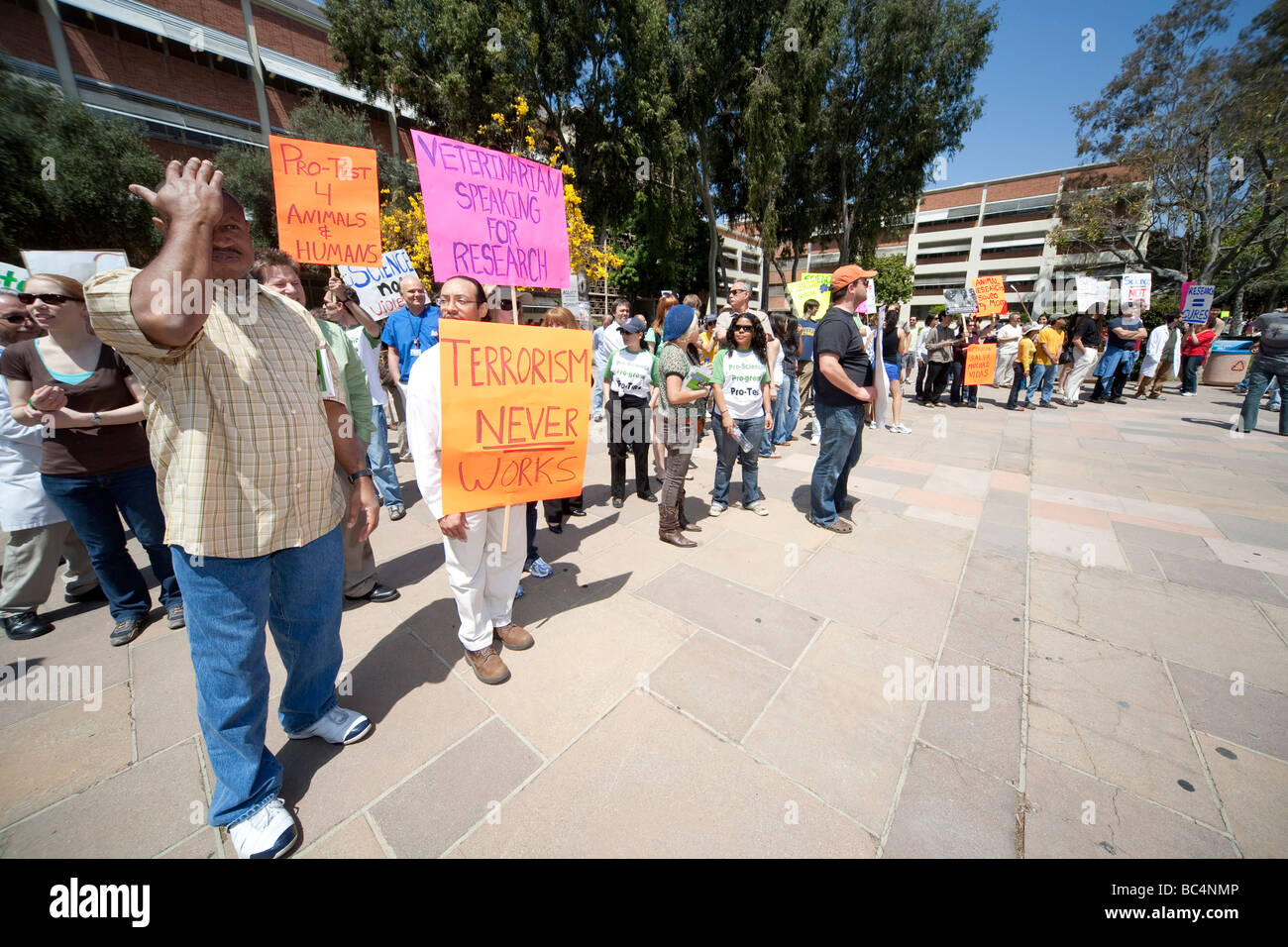 Participants of a pro research rally at UCLA defend the use of animals in biomedical research on Earth Day. - Stock Image