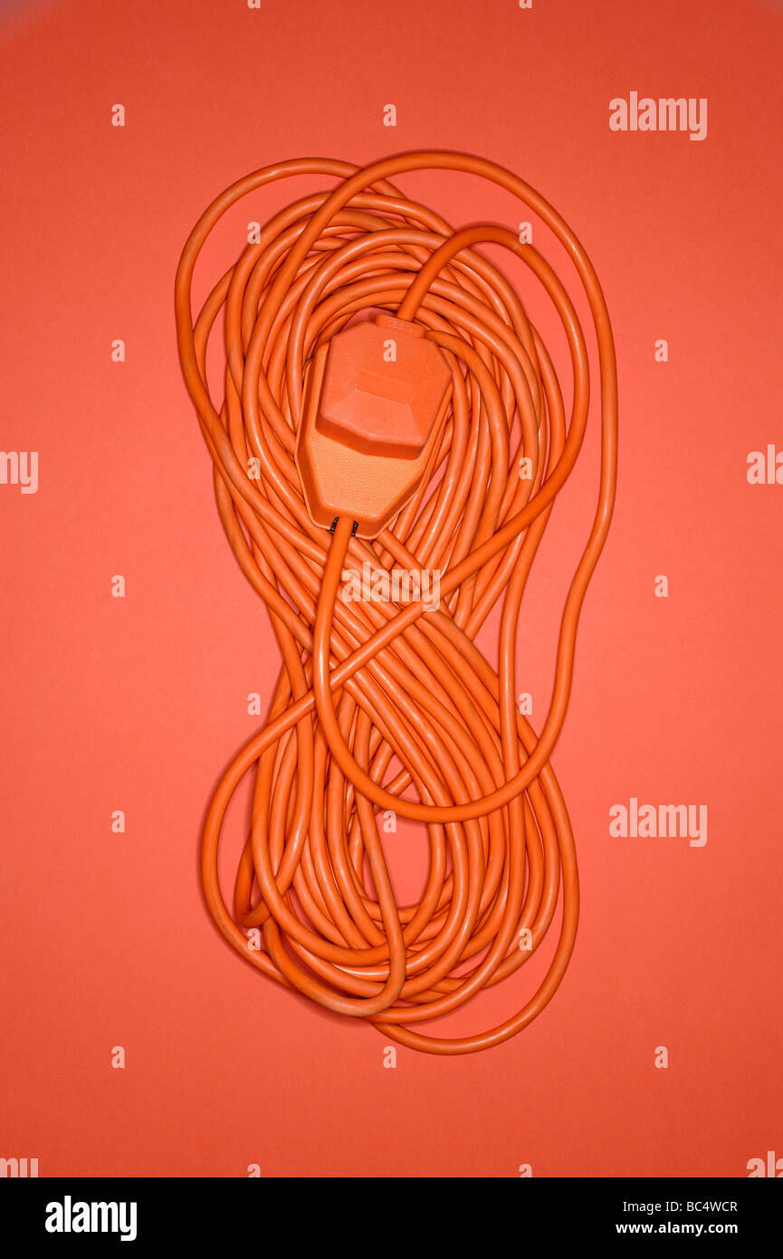 Coiled orange electrical cable - Stock Image