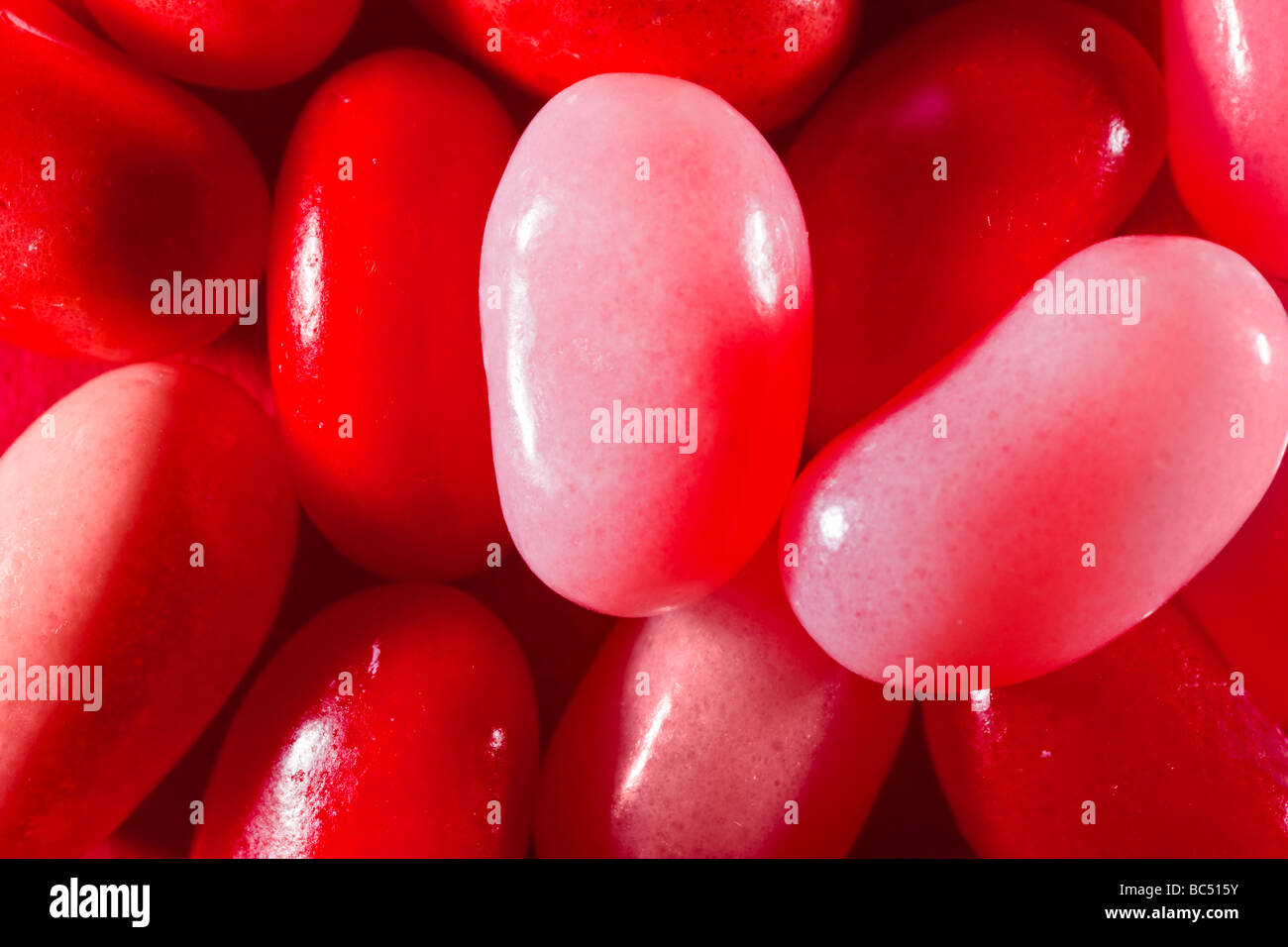Red and pink jelly beans captured in 16 bit and provided in Adobe1998 color space to hold difficult red tones - Stock Image