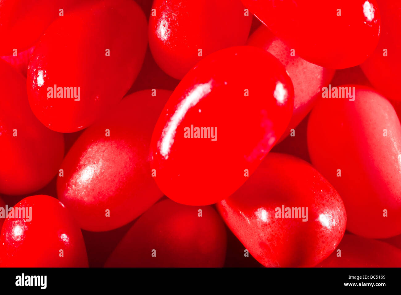 Red jelly beans captured in 16 bit and provided in Adobe1998 color space to hold difficult red tones - Stock Image