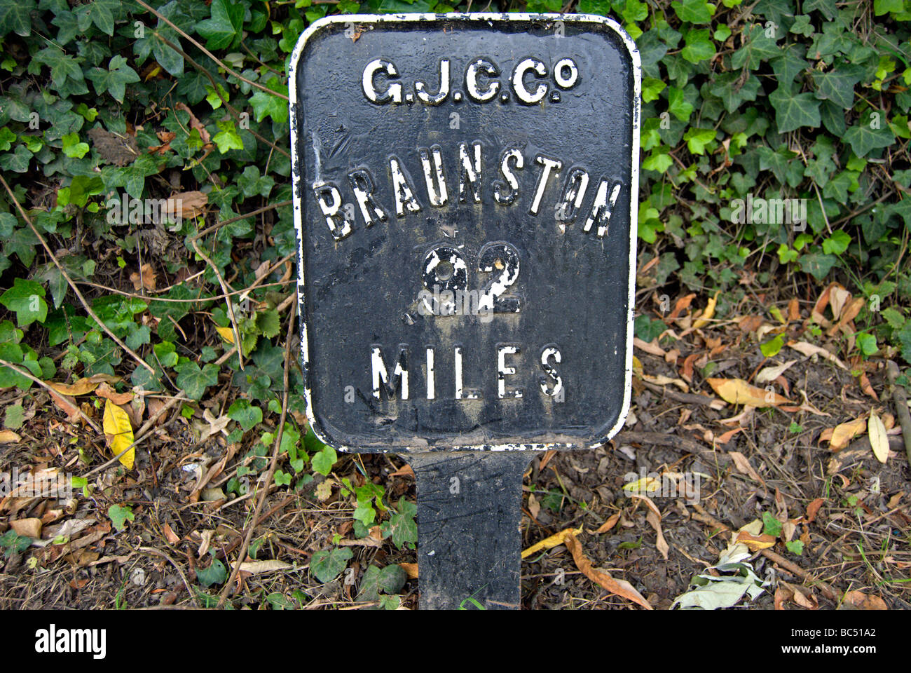 mile marker reading braunston 92 miles beside the grand union canal near brentford, london, england - Stock Image