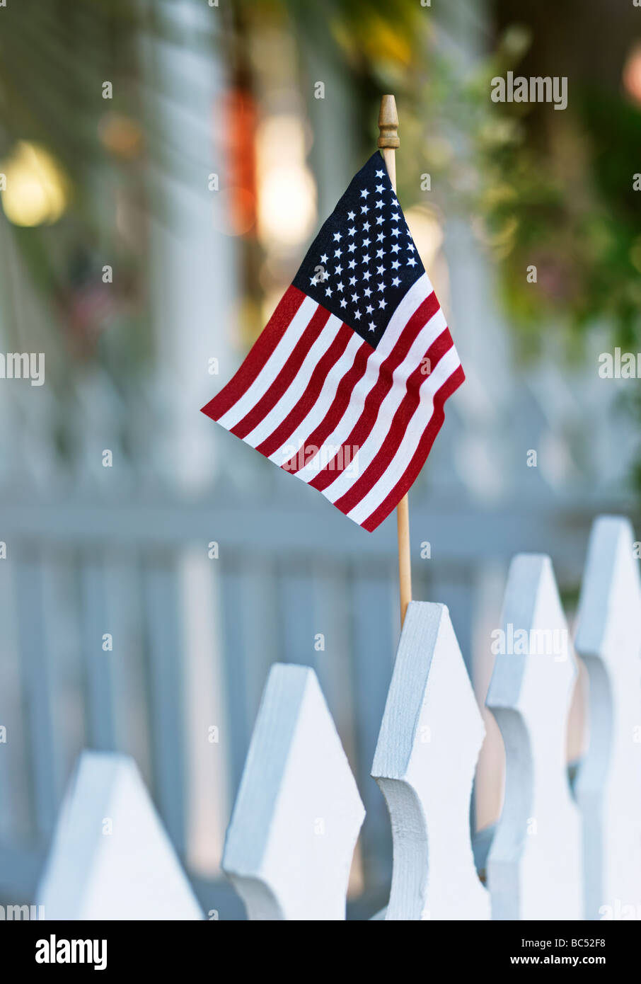 American flag on a picket fence - Stock Image
