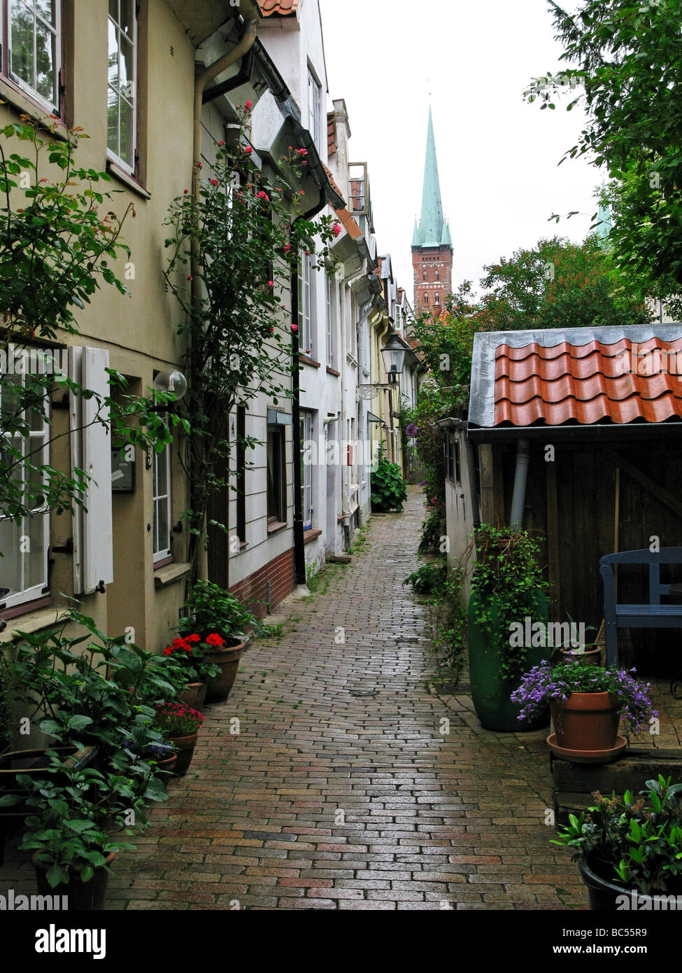 Schwans Hof Lane leading to the Church Steeple of St Petri Lubeck Germany - Stock Image