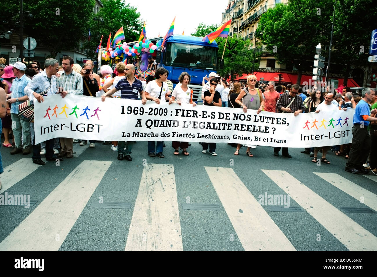 """Paris France, Public Events People Celebrating at the Gay Pride Parade """"French Sign"""" """"1969 - 2009 Proud of our Struggles"""", lgbt march banner, g Stock Photo"""