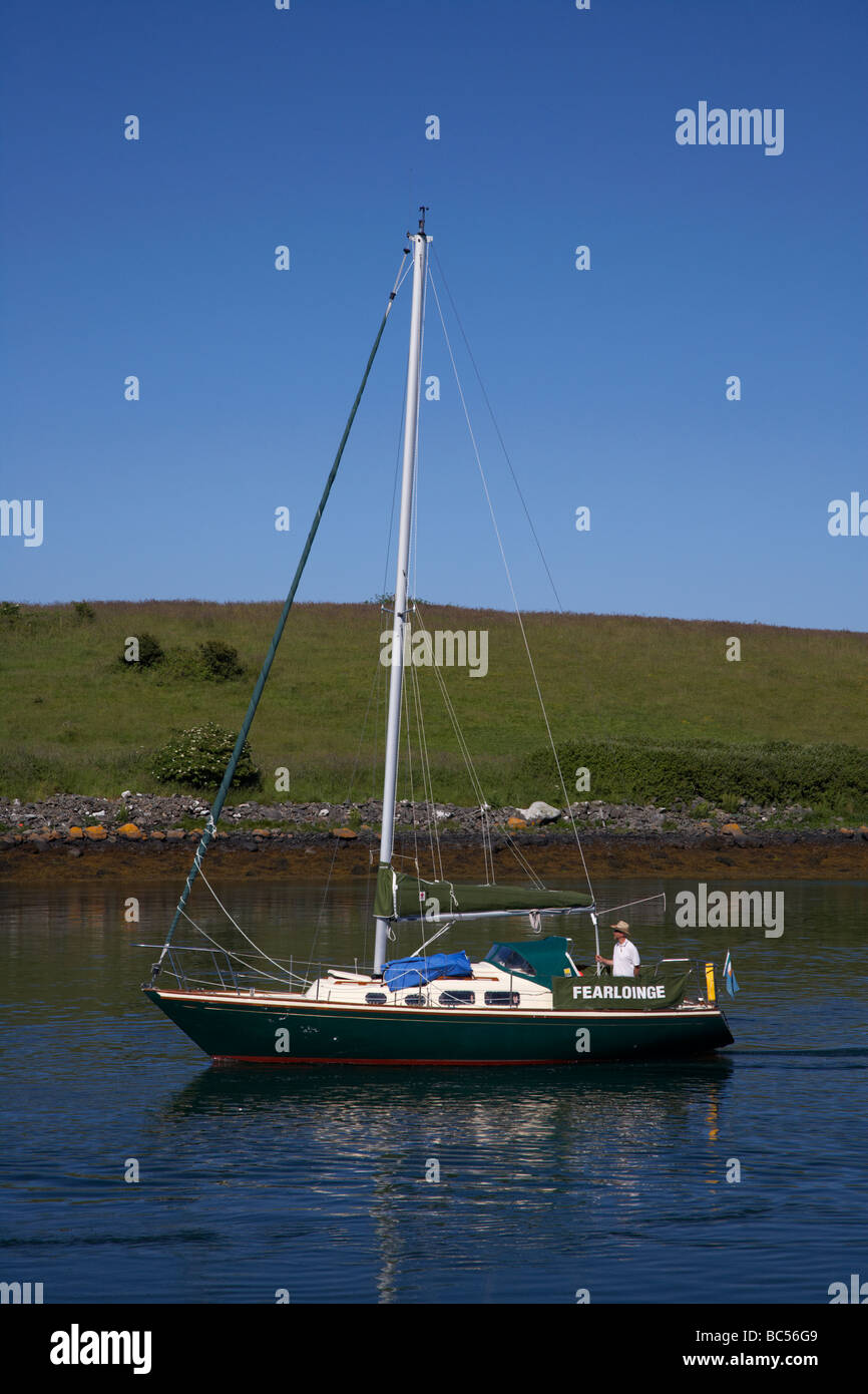 yacht motoring in one of strangford loughs many inlets county down northern ireland uk - Stock Image