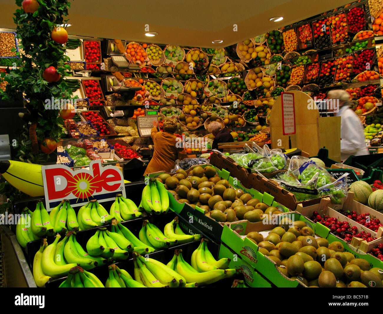 Woman Shoppers in a Fruit and Vegetable Shop - Stock Image