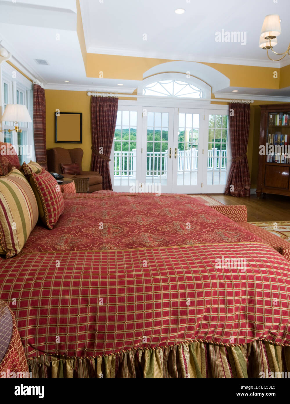Lovely Master Bedroom With King Size Bed Book Case And French Doors Stock Photo Alamy