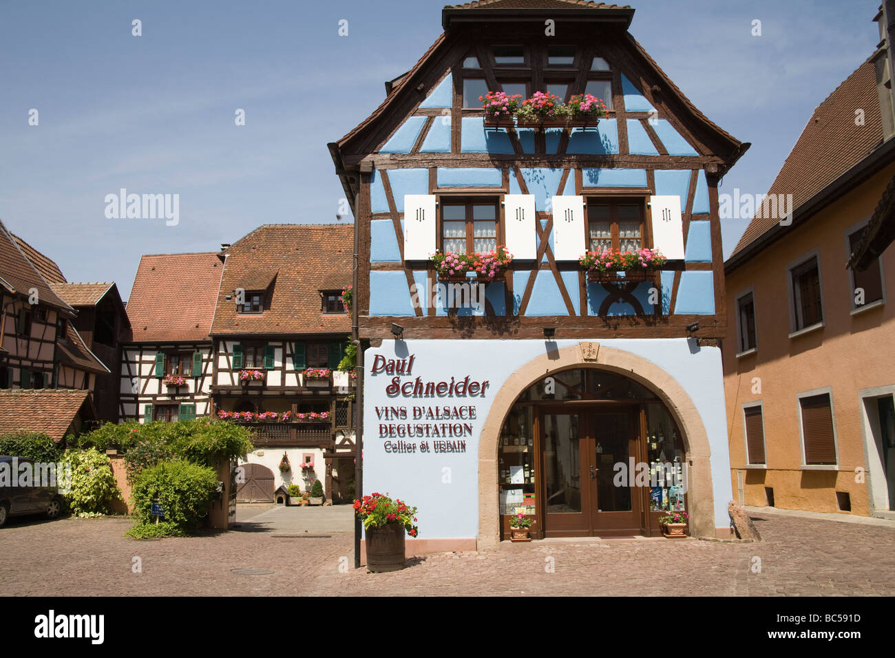 Eguisheim Alsace France EU Typical half timbered buildings of the region in a cobbled courtyard of this medieval - Stock Image