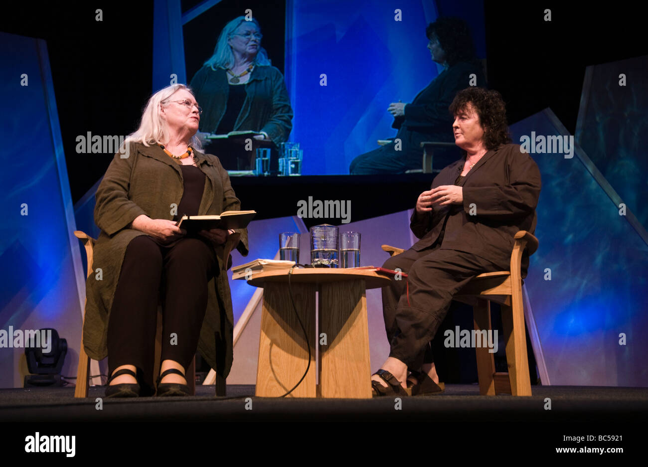 Poets Carol Ann Duffy (R) and Gillian Clarke (L) talking on stage at Hay Festival 2009 - Stock Image