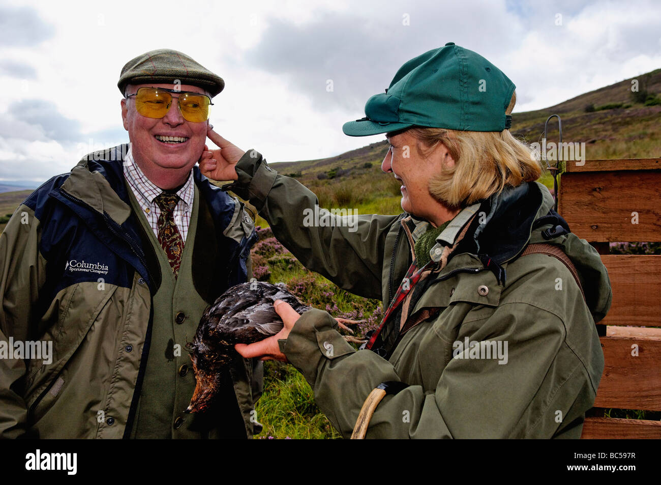 Woman Applying Blood to the Cheek of a Gunner after He Killed His First Red Grouse during Shoot in the Highlands Stock Photo