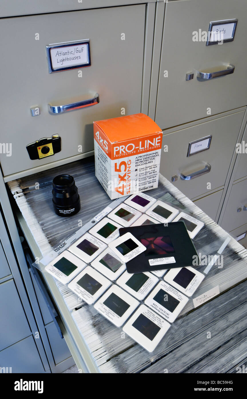 File Cabinet Slide Pages Medium Format Transparency Mount and Loupe in Photographers Office - Stock Image