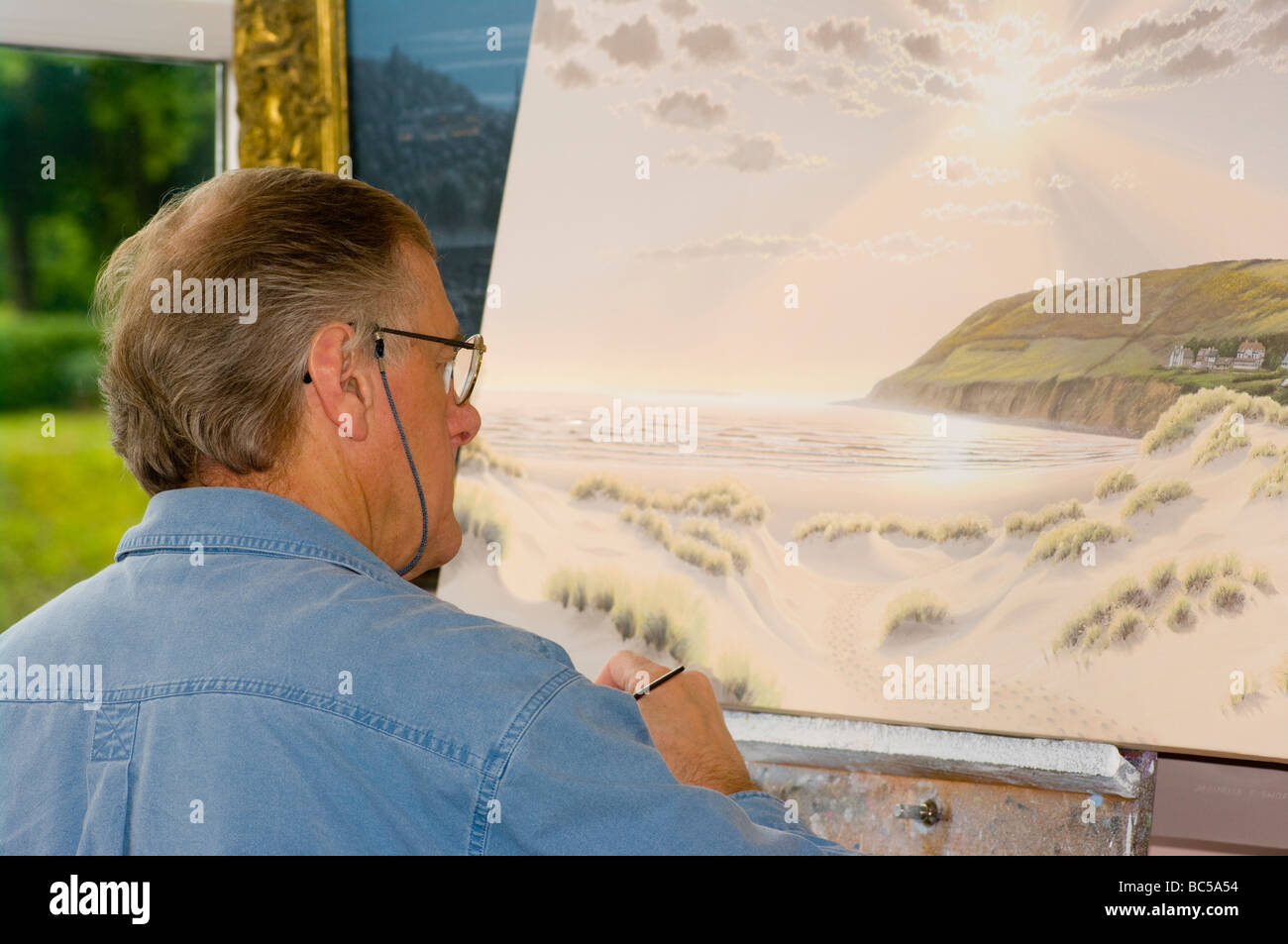Artist Painting A Scene In His Studio - Stock Image
