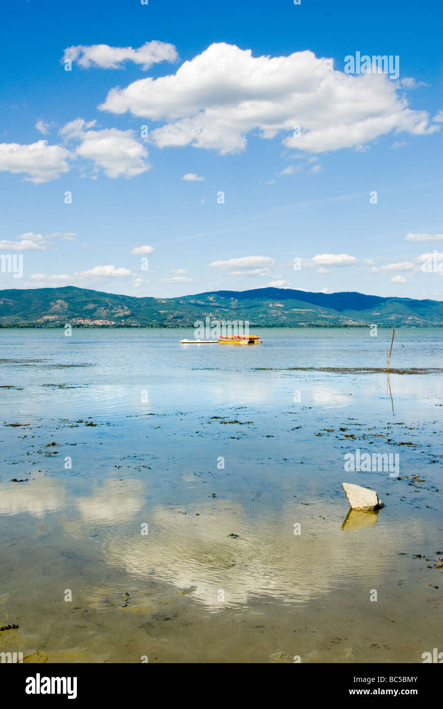 Mirrored surface of Lago Trasimeno the main lake in Umbria Stock Photo