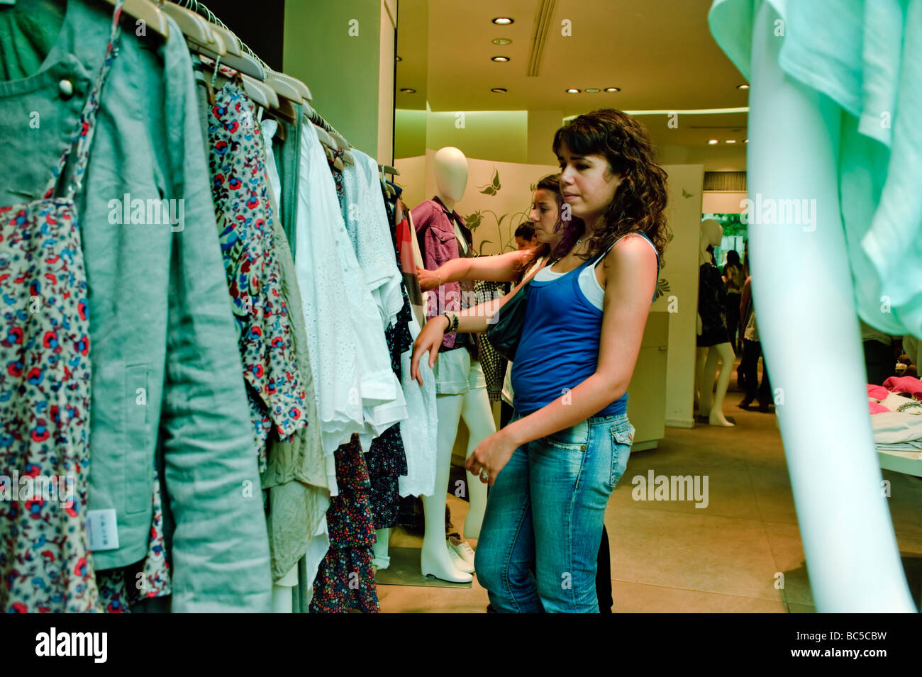 Paris France, Clothes Shopping Woman in Sandro Shop, in the Marais, Boutique 'Summer Sales' - Stock Image