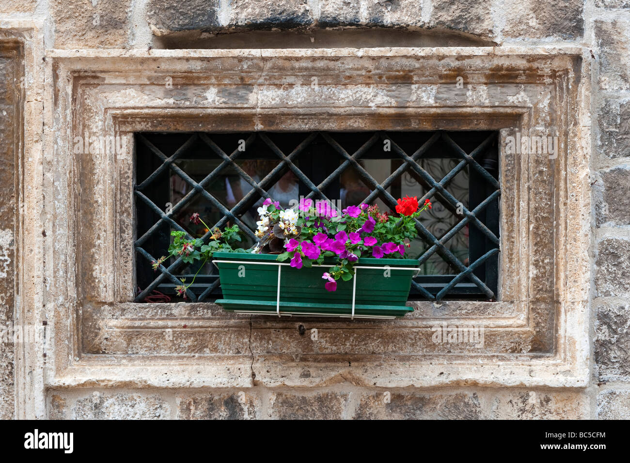 Flowers in a window box in the old walled city of Dubrovnik, Croatia - Stock Image