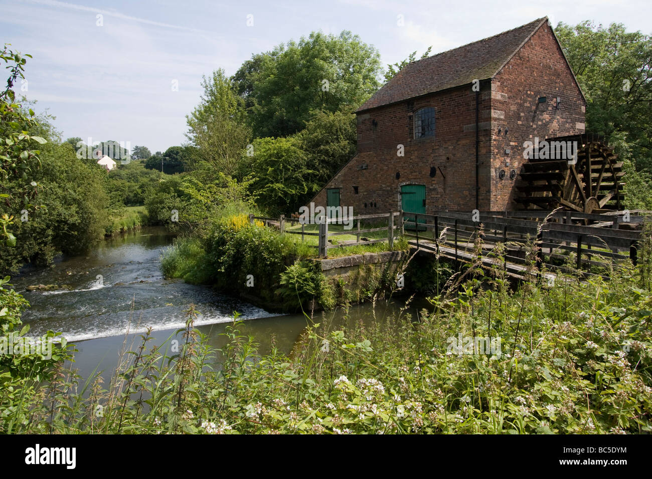 Cheddleton Flint Mill is a water mill situated in the village of Cheddleton in the English county of Staffordshire. - Stock Image
