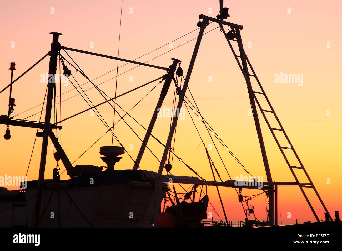 Masts of the fishing boat in Hasting sussex in the evening England - Stock Image