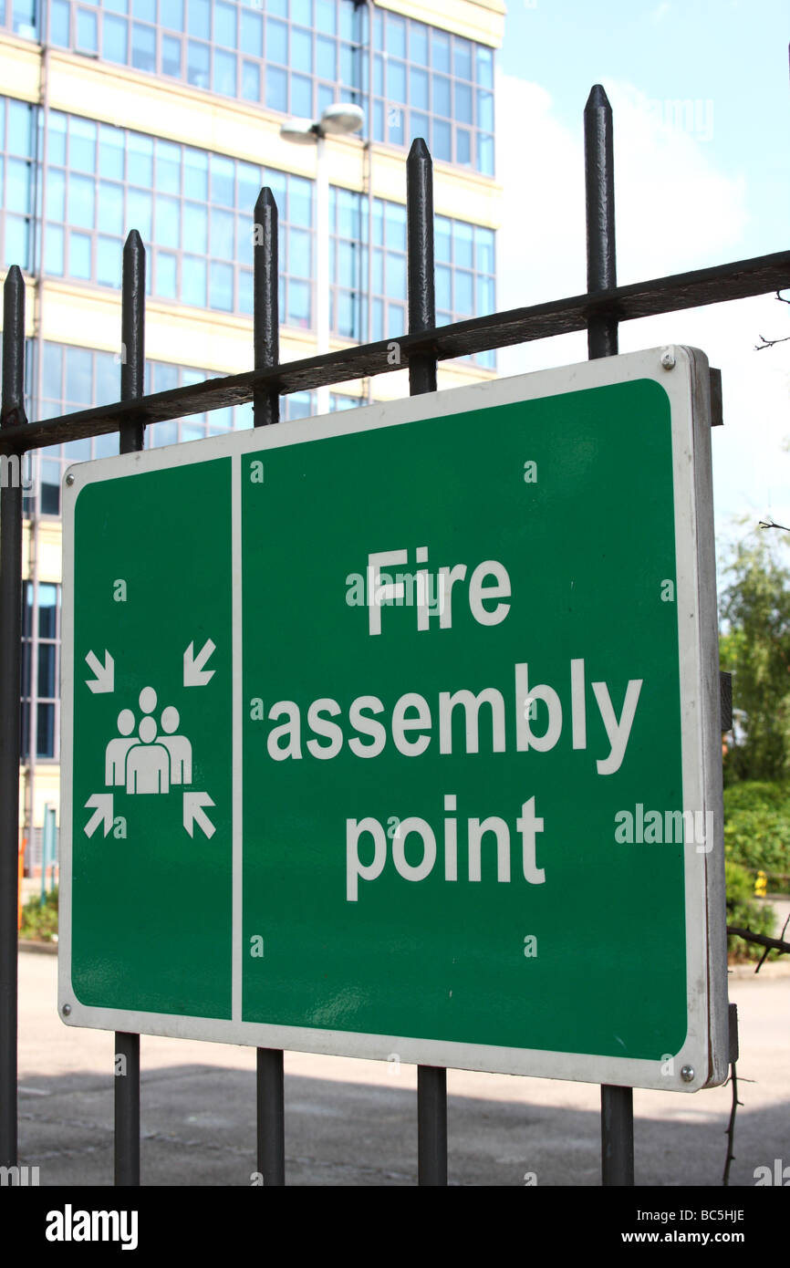 A fire assembly point sign. - Stock Image