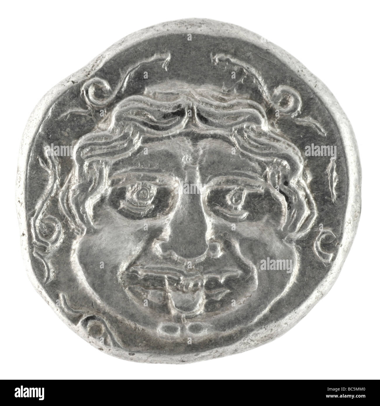 Medusa on ancient Greek half drachm from 300 BC - Stock Image