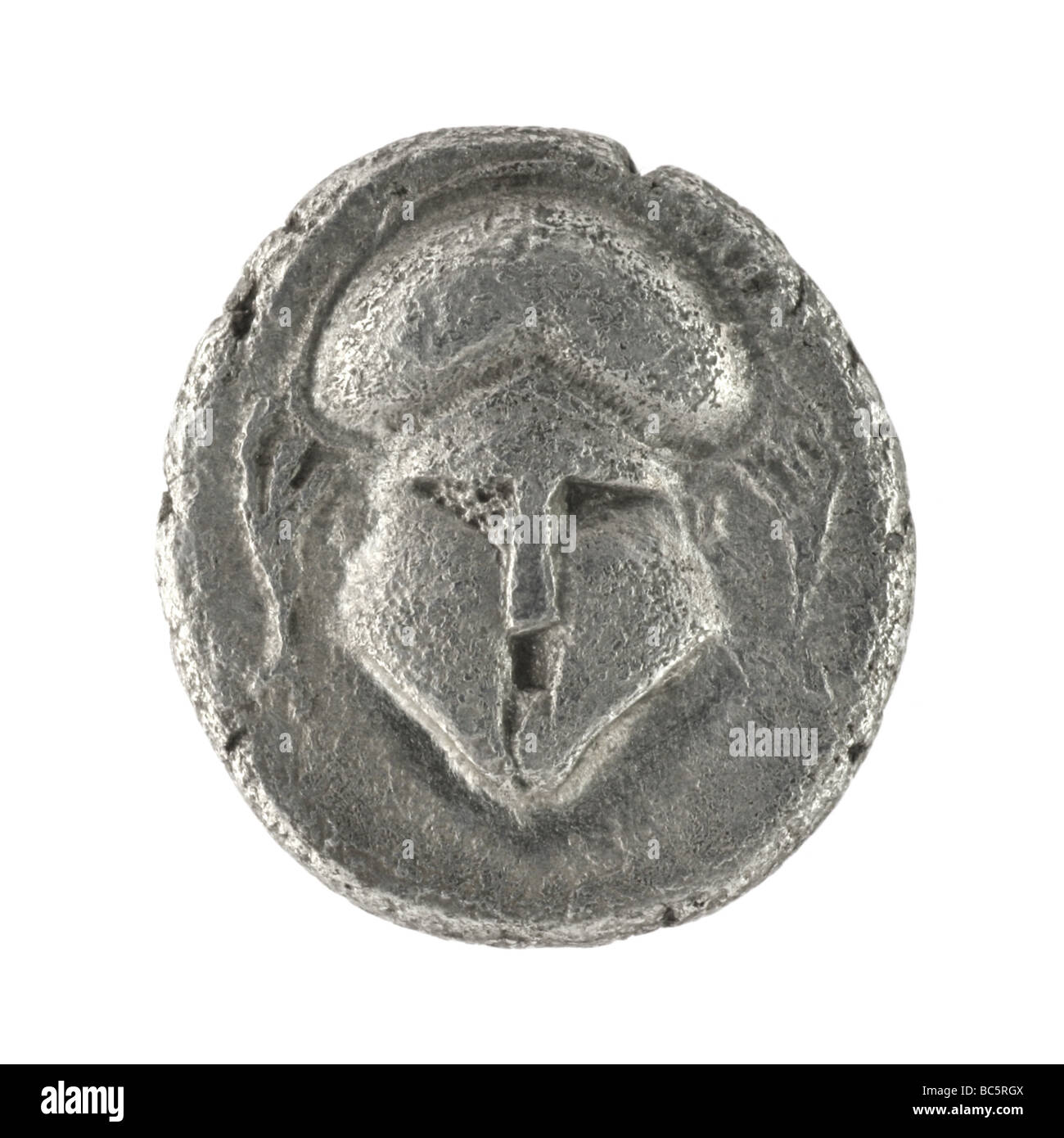 Crested helmet on ancient Greek diobol from 350 BC - Stock Image