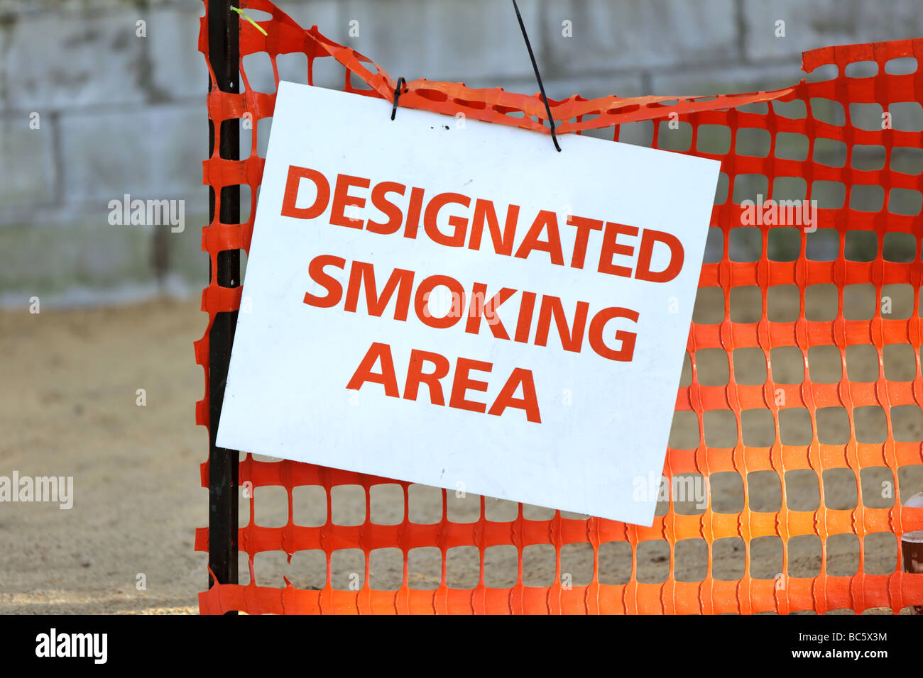 An area set aside for those who want to smoke - Stock Image