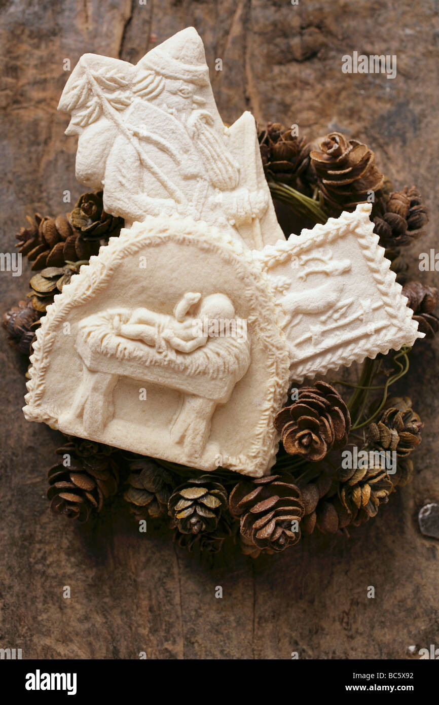 Three Different Springerle Cookies On Wreath Of Pine Cones Stock