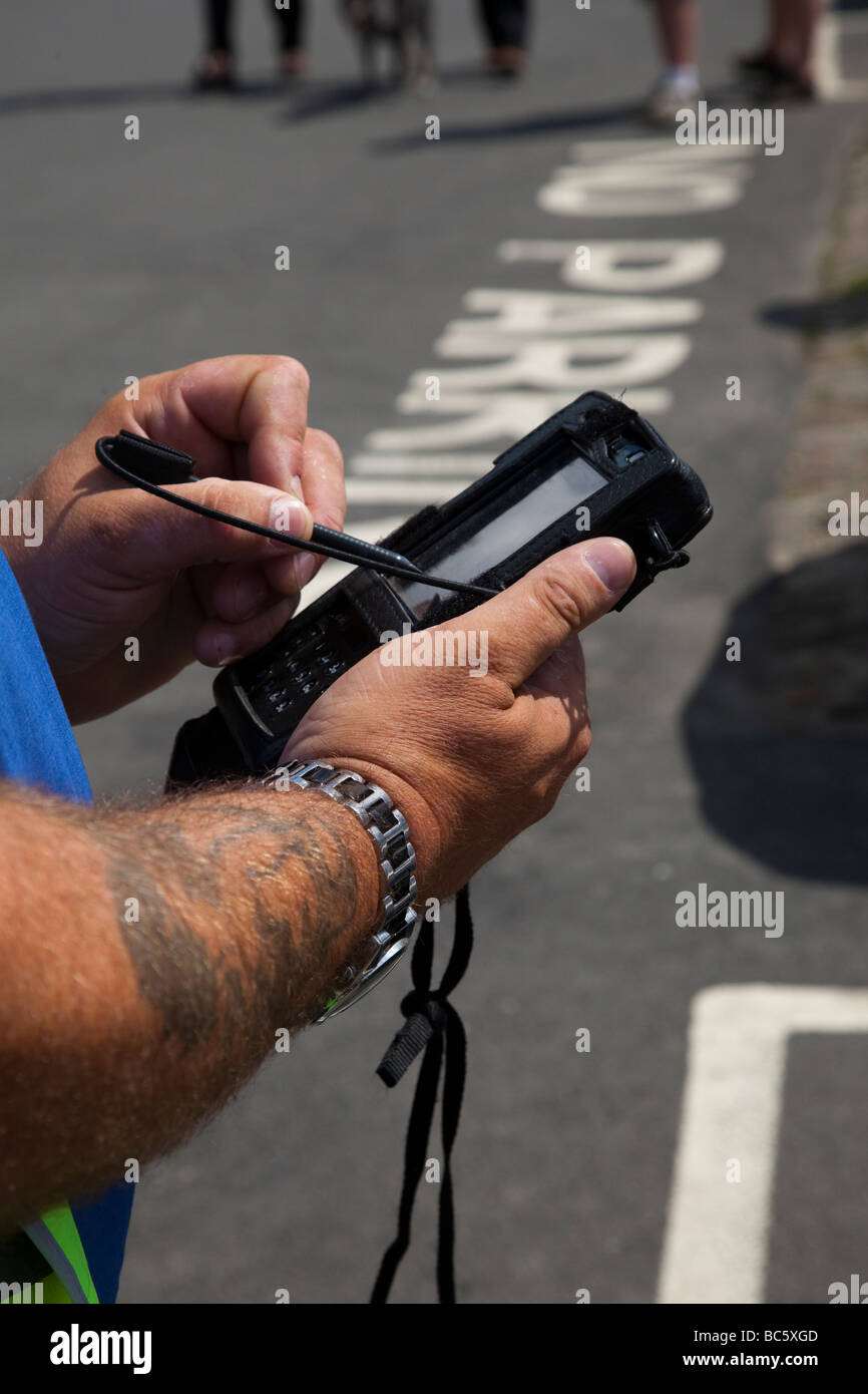 Parking meter attendant issuing ticket, North Yorkshire UK - Stock Image