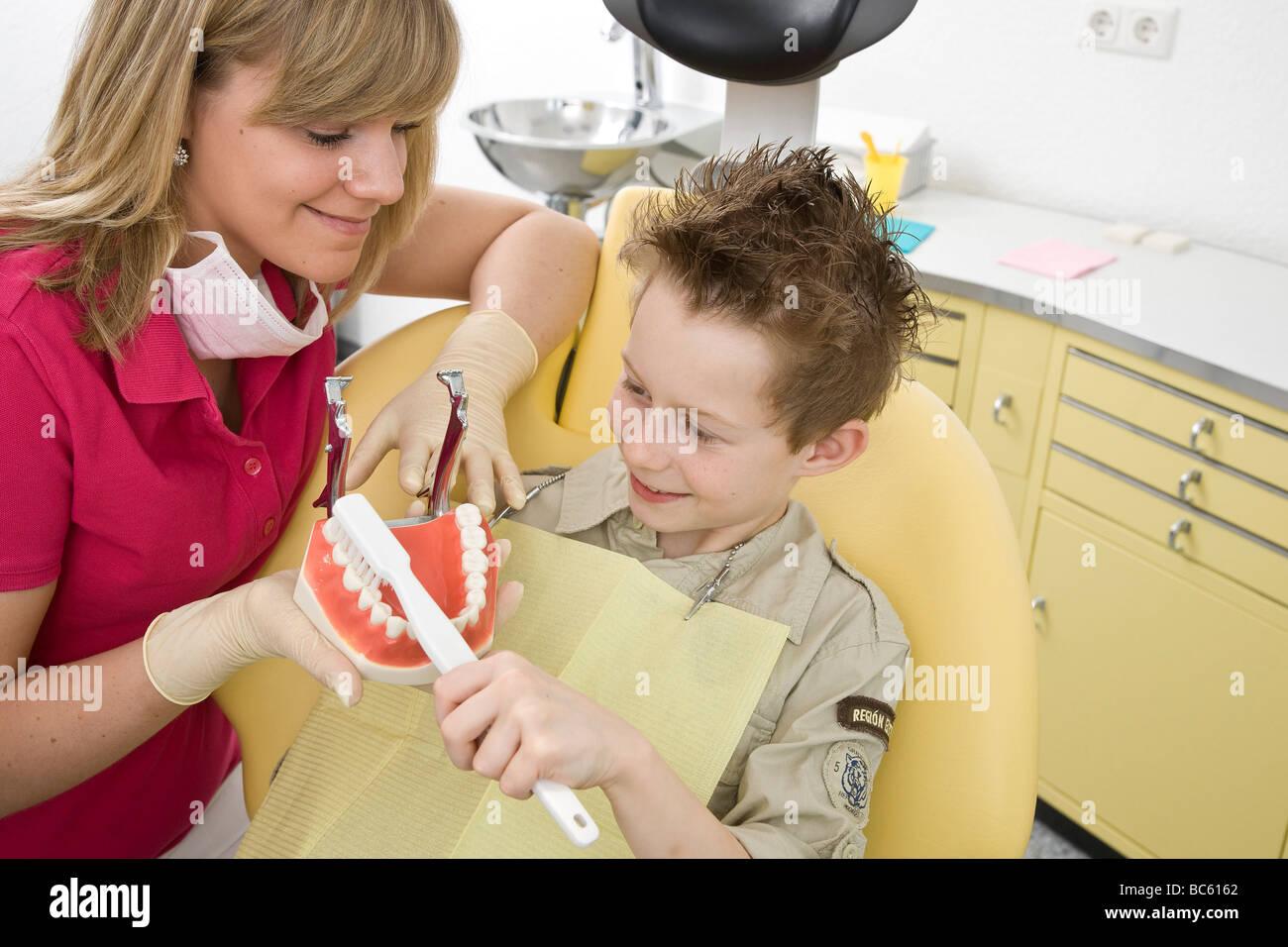 Boy at dentist - Stock Image