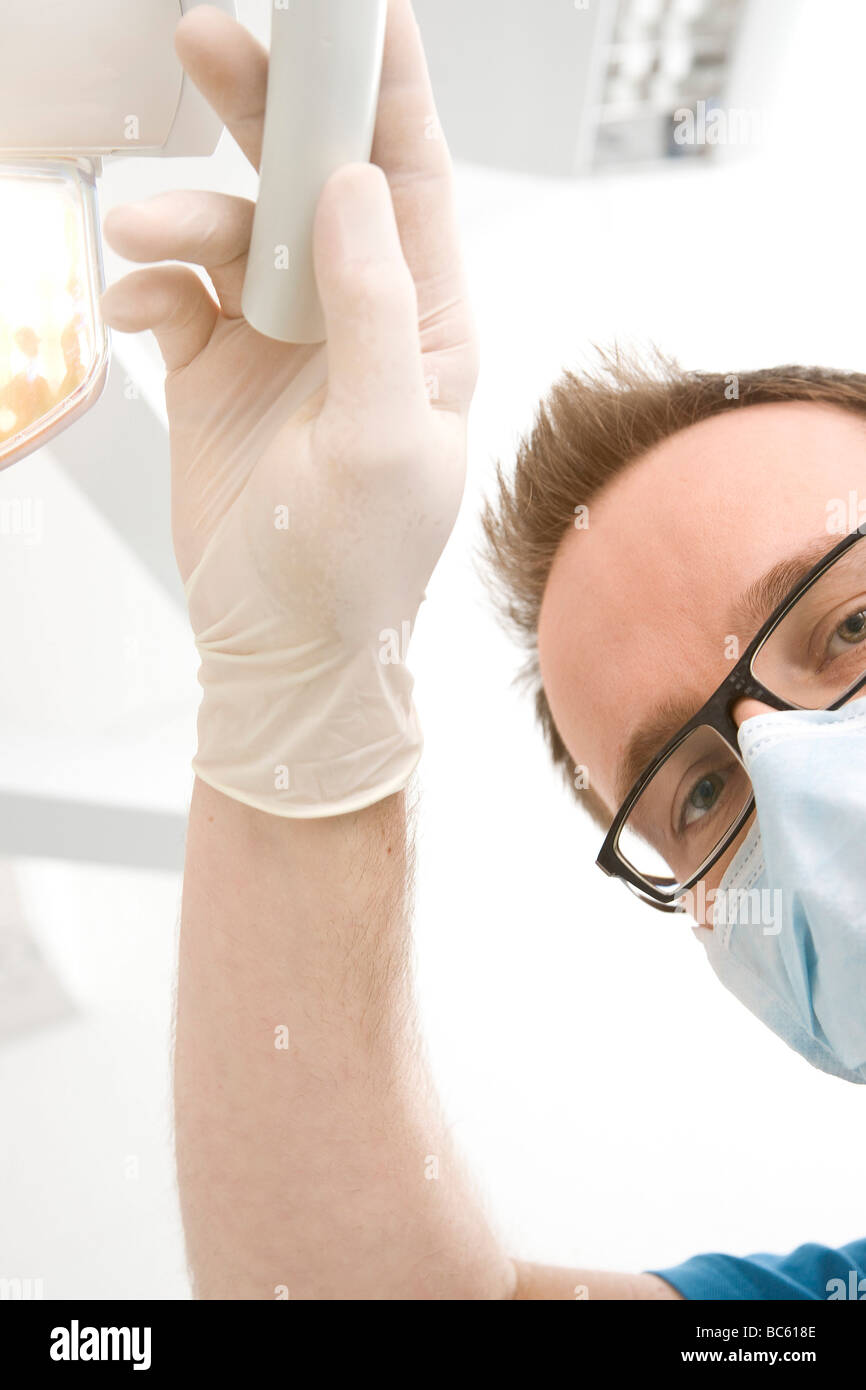 Portrait of male dentist wearing surgical mask - Stock Image