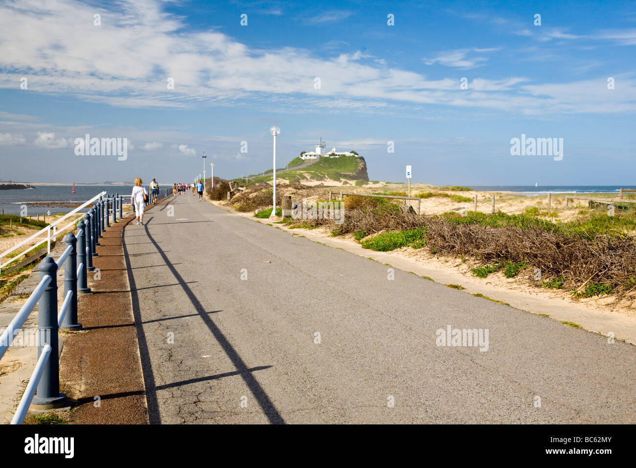 Walking out to Nobbys Head along the path next to the Beach, Newcastle, New South Wales. Australia Stock Photo