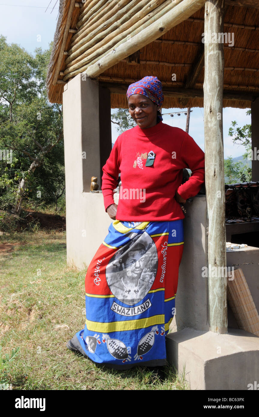 African woman wearing a snrong  printedwith the face of King Mswati 111 of Swaziland south Africa - Stock Image