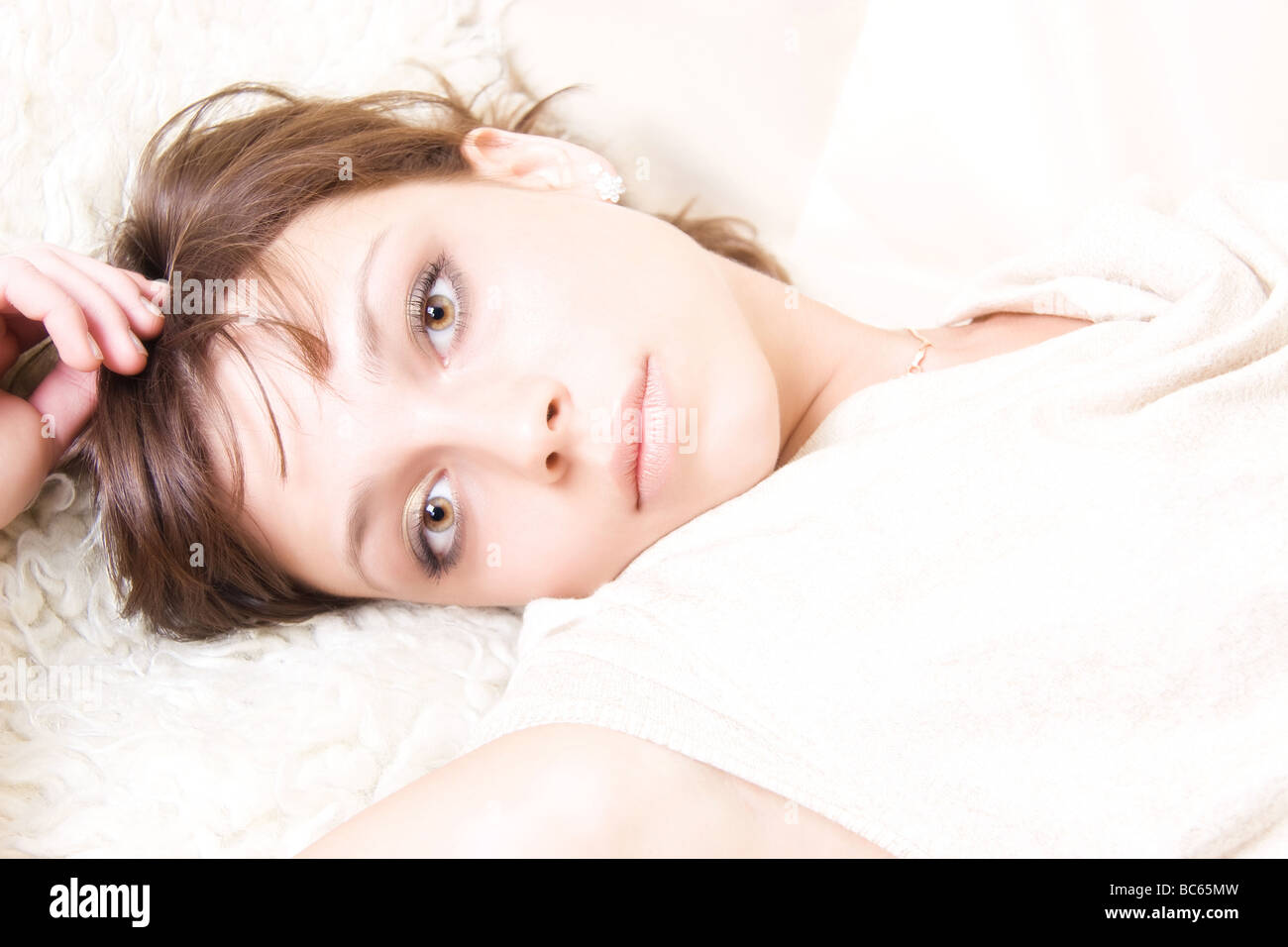 Resting woman portrait Bright lighting without shadows - Stock Image