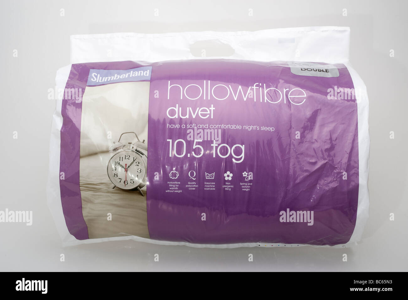 Hollowfibre duvet plastic carrier bag - Stock Image