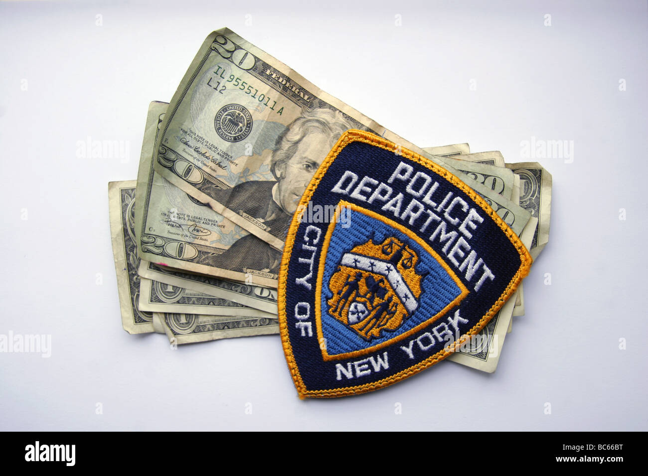 Police patch of the NYPD and American dollar bills - Stock Image