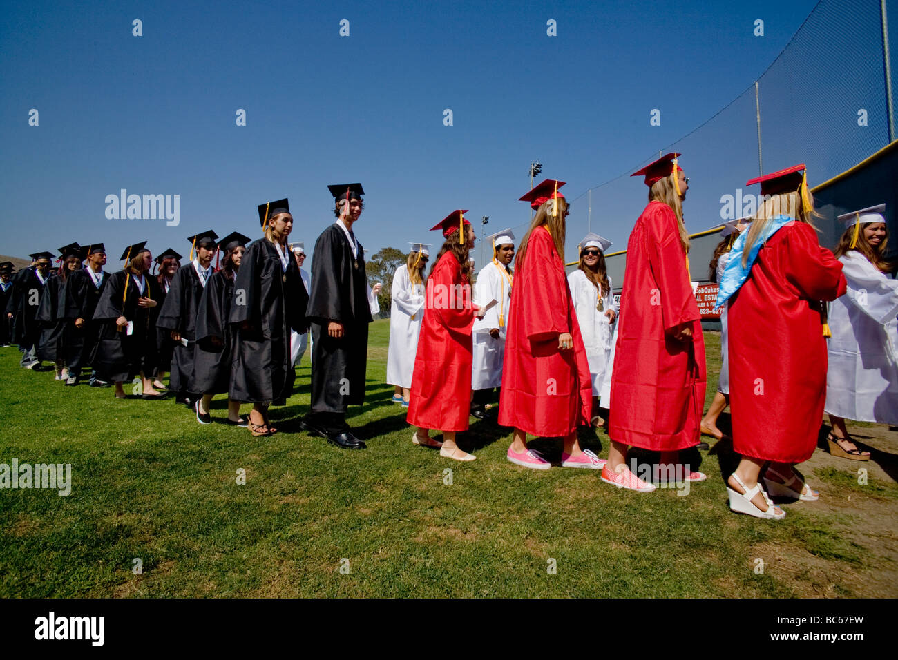 There were tears as well as cheers among high school graduates in Costa Mesa, CA. - Stock Image