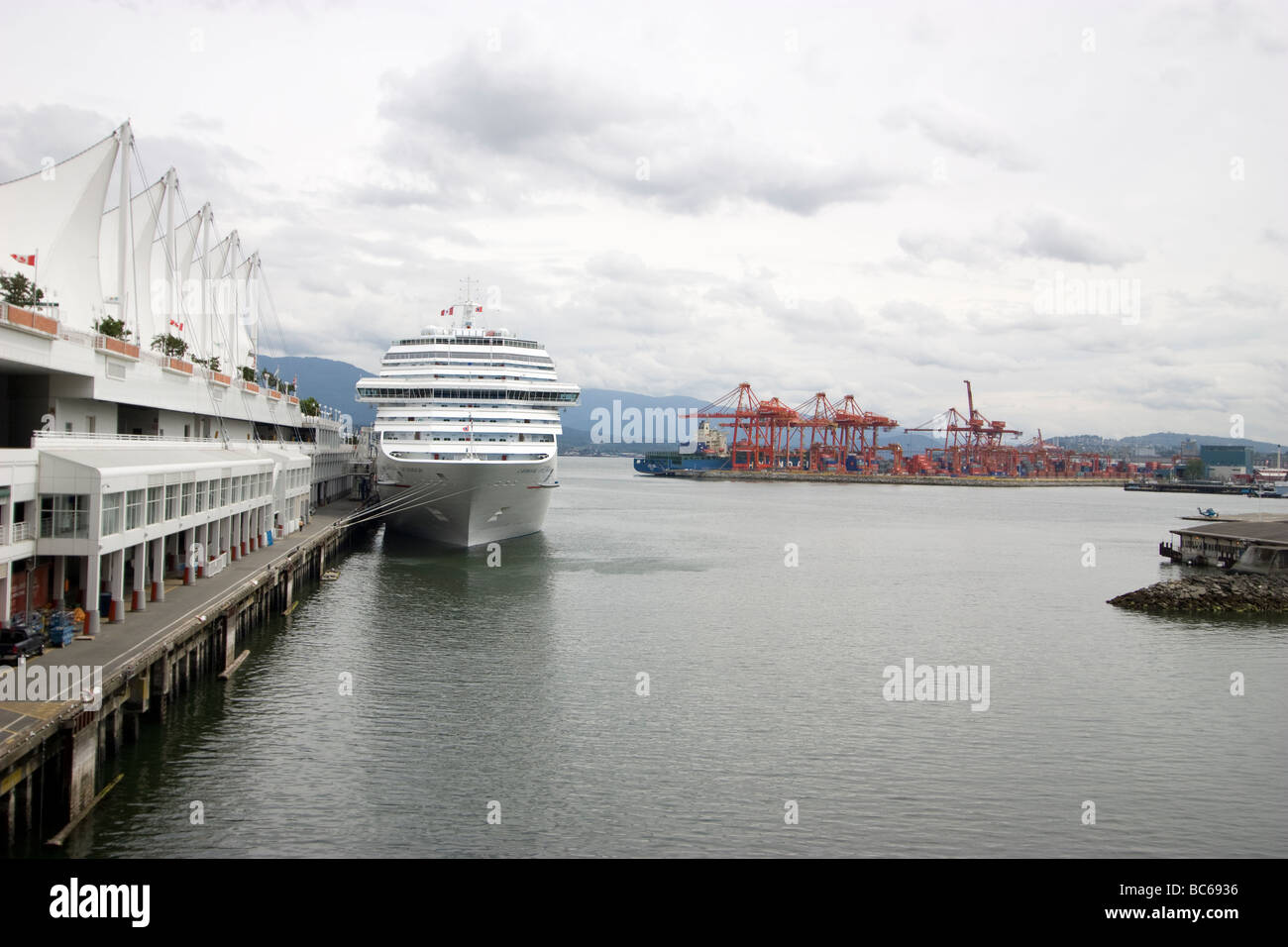 Carnival splendor cruise liner downtown Vancouver with port in background - Stock Image