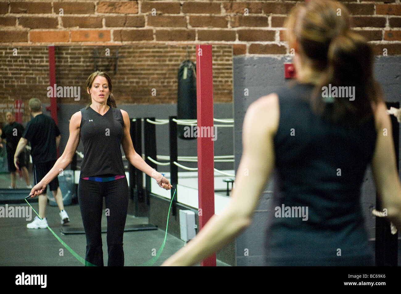 A young female athlete trains at the gym. - Stock Image