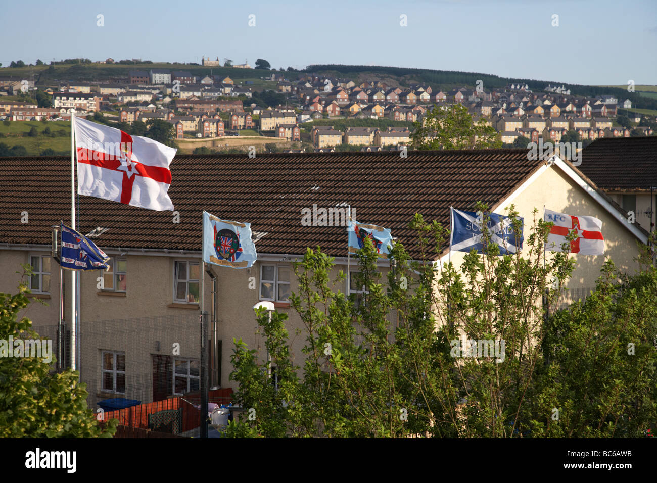 the fountain estate flying loyalist flags in derry city county derry northern ireland uk - Stock Image