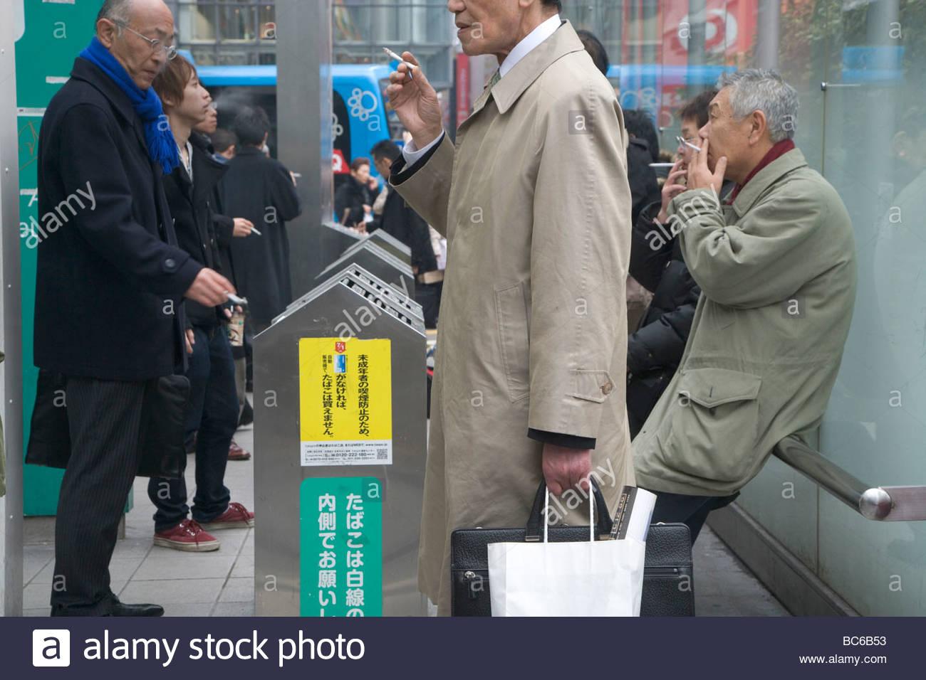 designated smokers area tokyo at Shibuya station - Stock Image