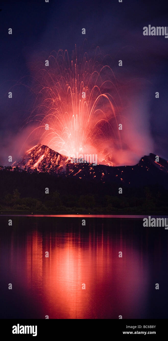Volcanic eruption at night - Stock Image