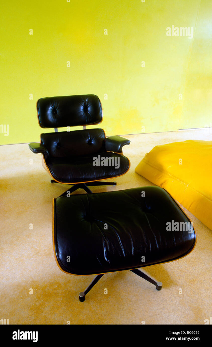 Black Leather Eames Chair With Foot Stool Stock Photo